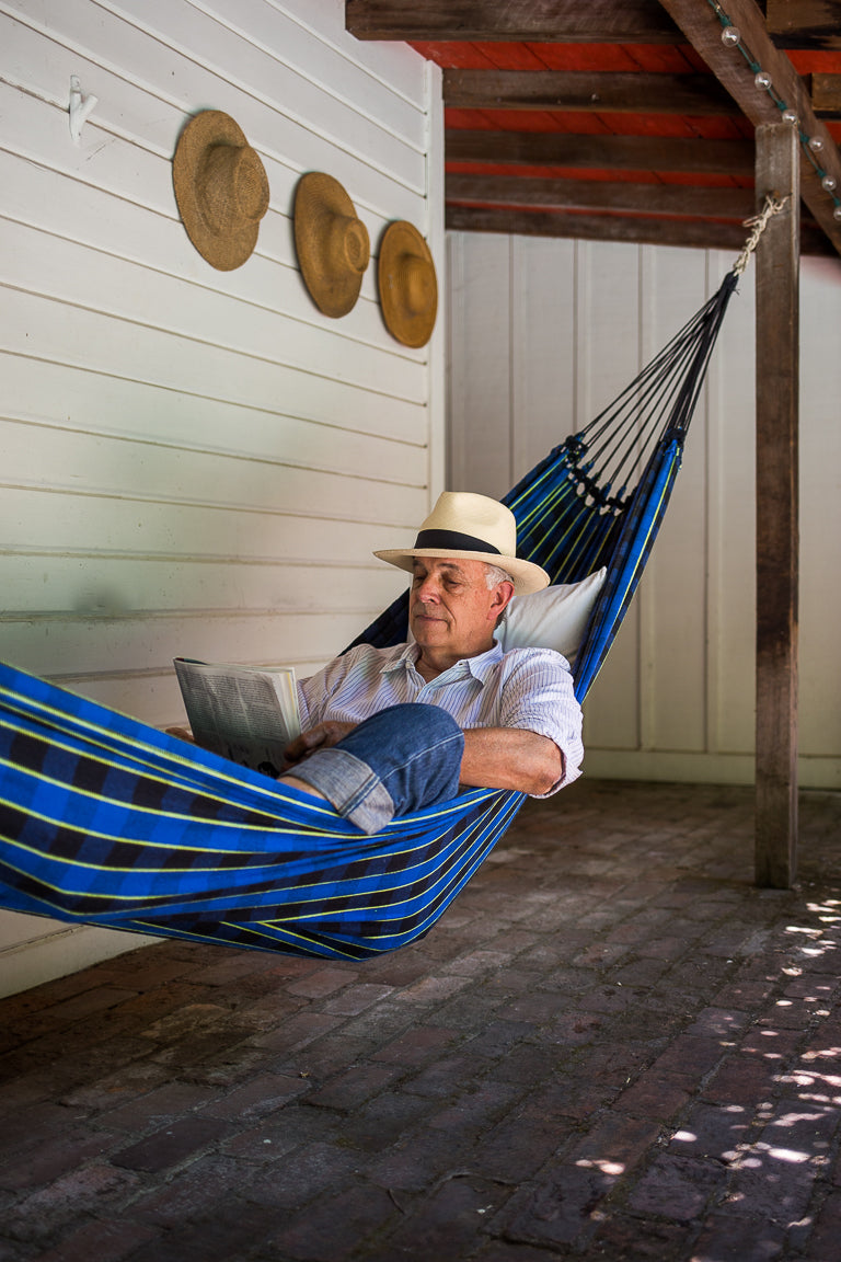 white man reading in maria canta hammock