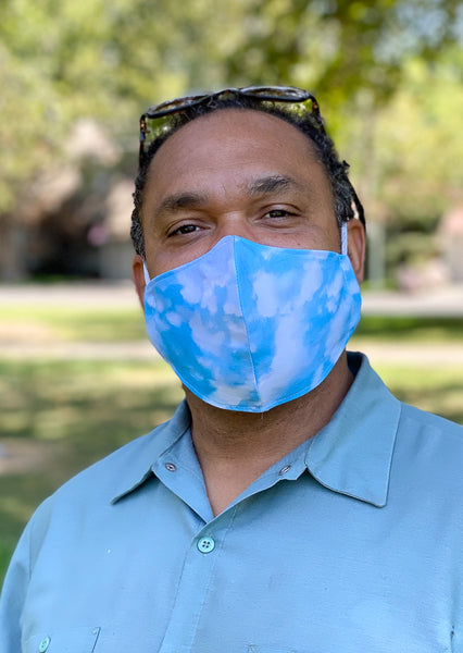 handsome black man wearing clouds face mask