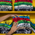 stacks of colorful screen printed t shirts, maria canta, hands