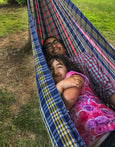 father and daughter in hammock maria canta