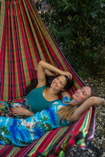 women in maria canta hammock queer couple