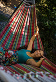 woman in plaid hammock