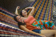 two women in plaid hammock