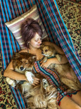 woman with dogs in hammock