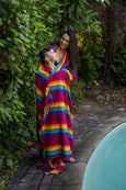 mother and son wraped in rainbow blanket