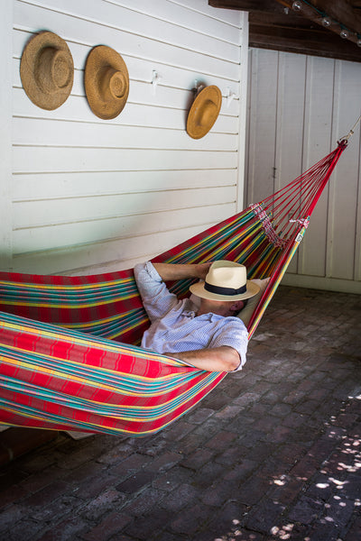 man sleeping in brazilian hammock
