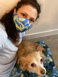 woman and dog wearing starry night handmade face mask