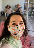 woman socially distancing wearing sushi face mask