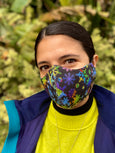 woman wearing rainbow snowflake face mask