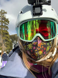 woman skiing with rainbow snowflake face mask
