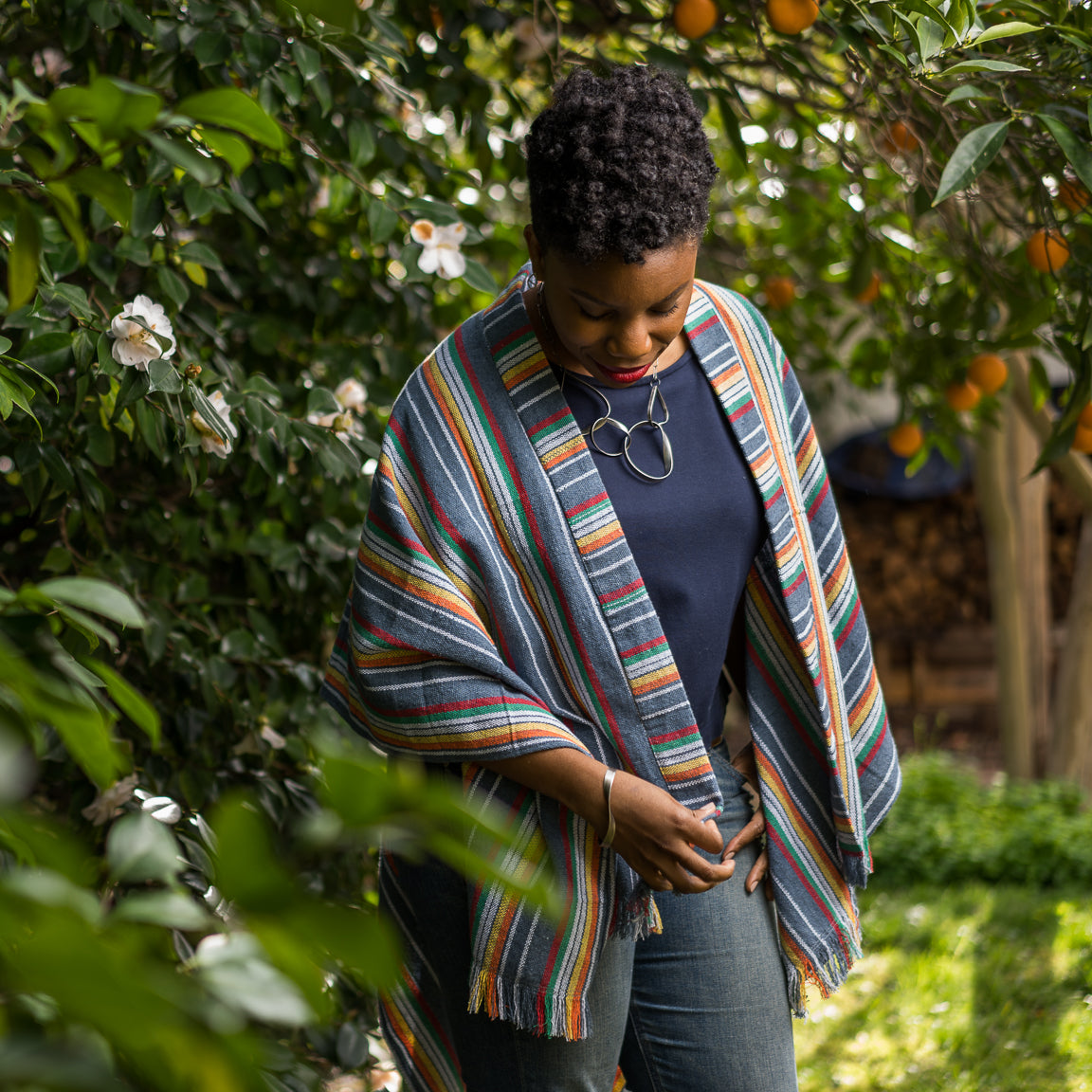 woven cotton poncho african american model in the garden maria canta