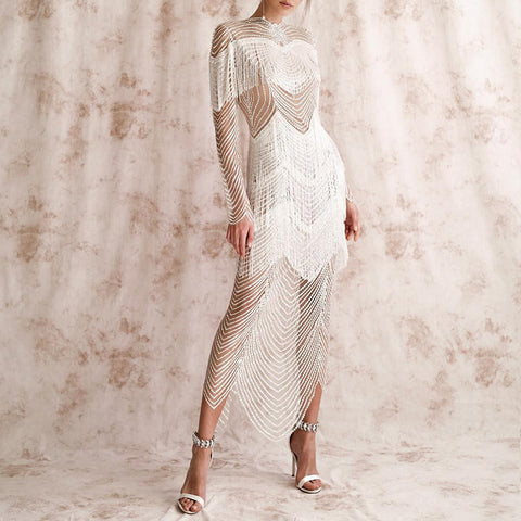 Fashionable long - sleeved fringe hollow-out dress