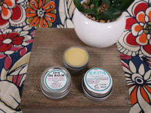 Load image into Gallery viewer, lip balm and skin balm made with vanilla-infused jojoba oil, beeswax, and vanilla extract