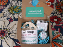 Load image into Gallery viewer, gift box including unsoap butter scrub bar with pink himalayan salt exfoliant, loofah to set unsoap on, calm balm, and unlotion solid lotion bar, with gift tag and pull bow