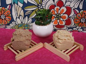 unsoap butter scrub bars, one with ground apricot shells exfoliant and one with pink himalayan salt exfoliant
