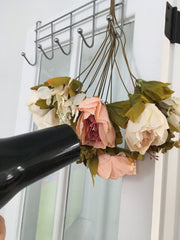use a hair dryer to rejuvenate artificial flowers