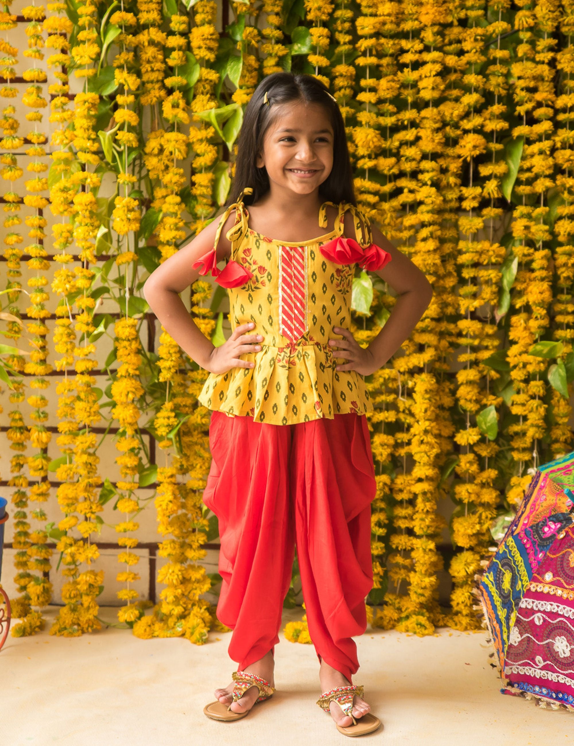 Yellow Sleeveless Top with Red Dhoti