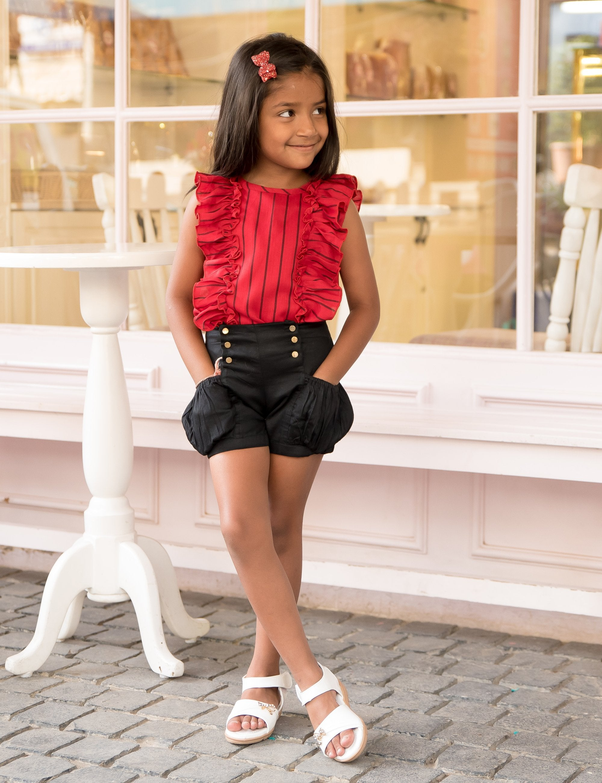 Red Frilly Top and Black Shorts