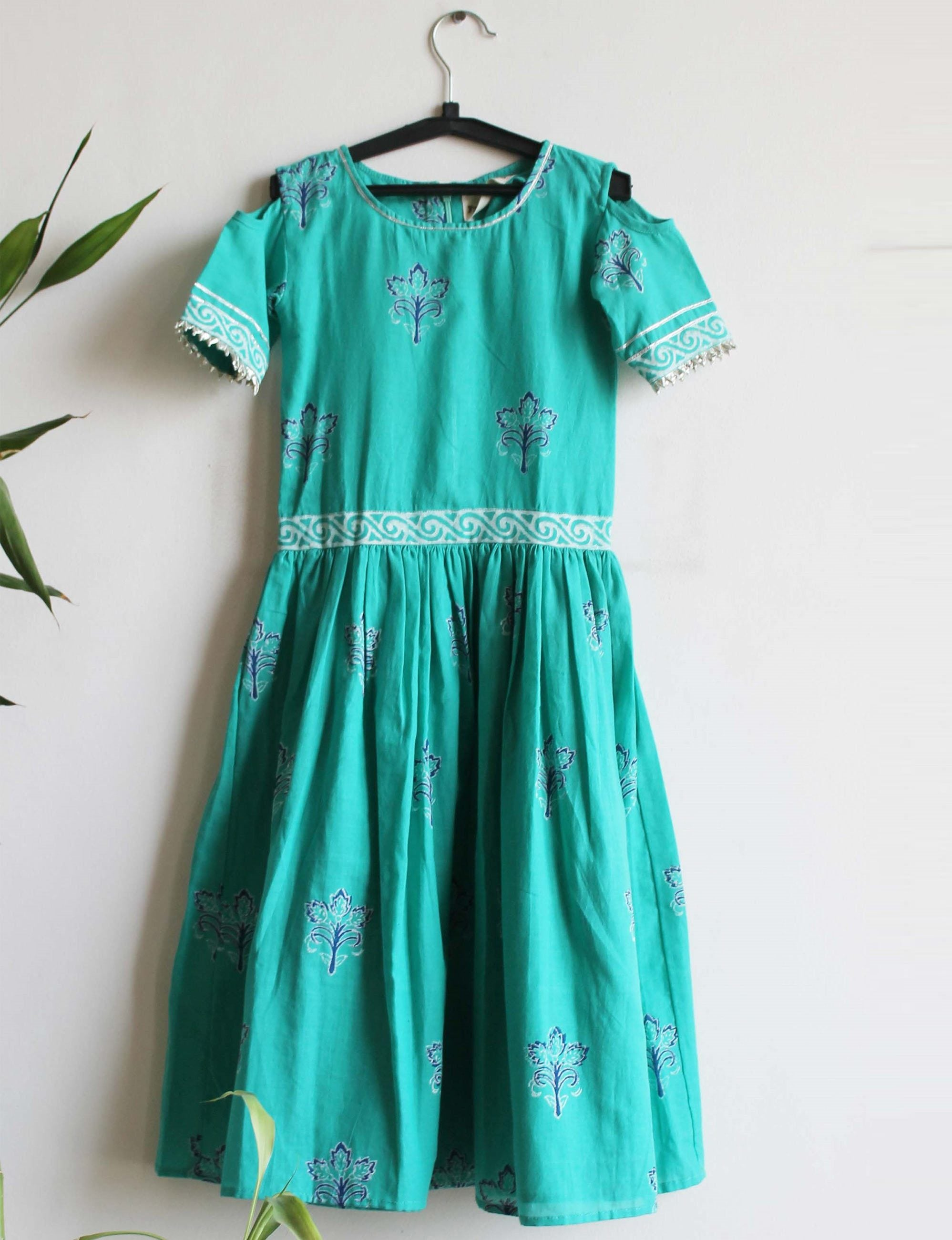 A Cold Shoulder Dress in Green Colour for Girls