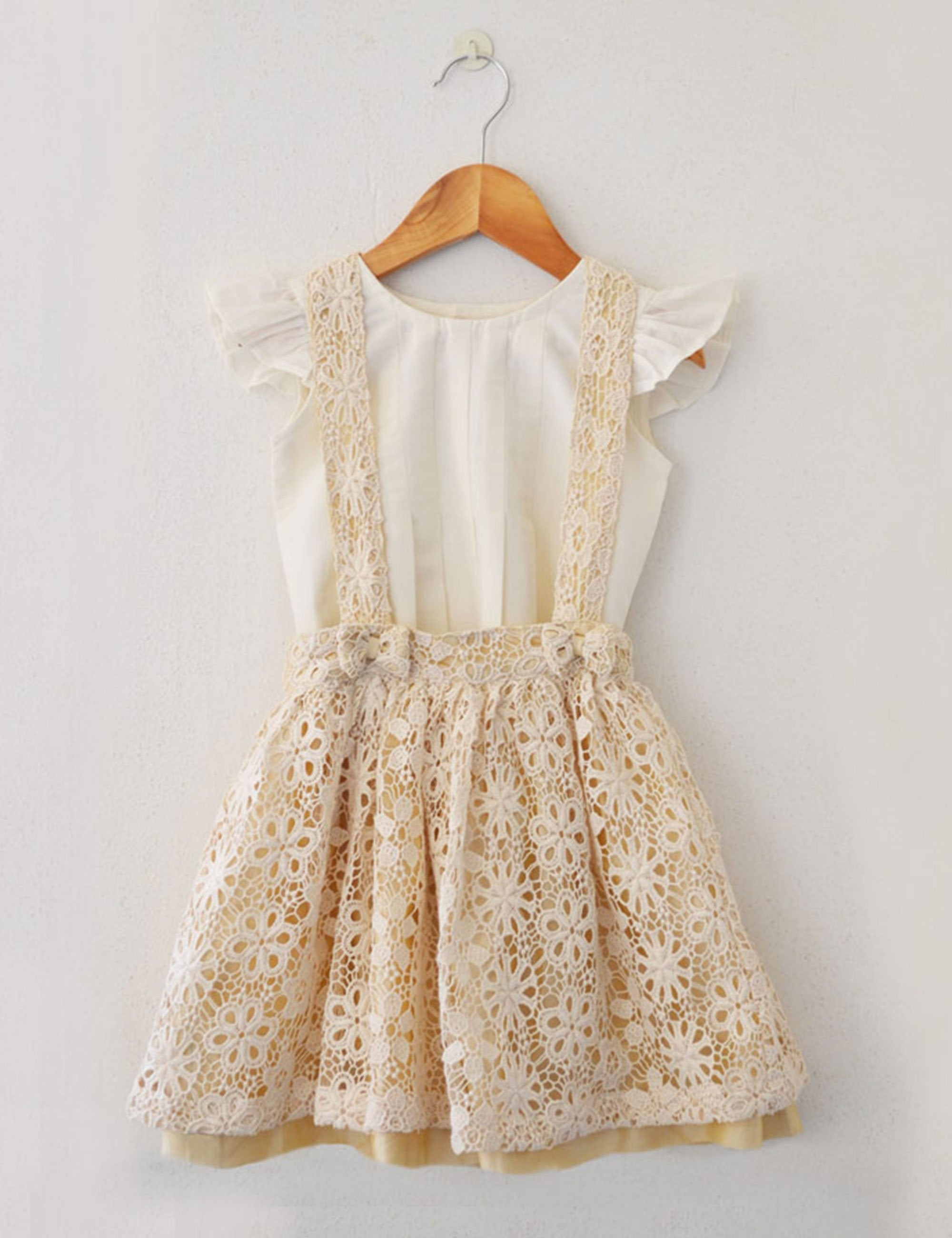 Linen dress in beige colour with lace pattern for girls