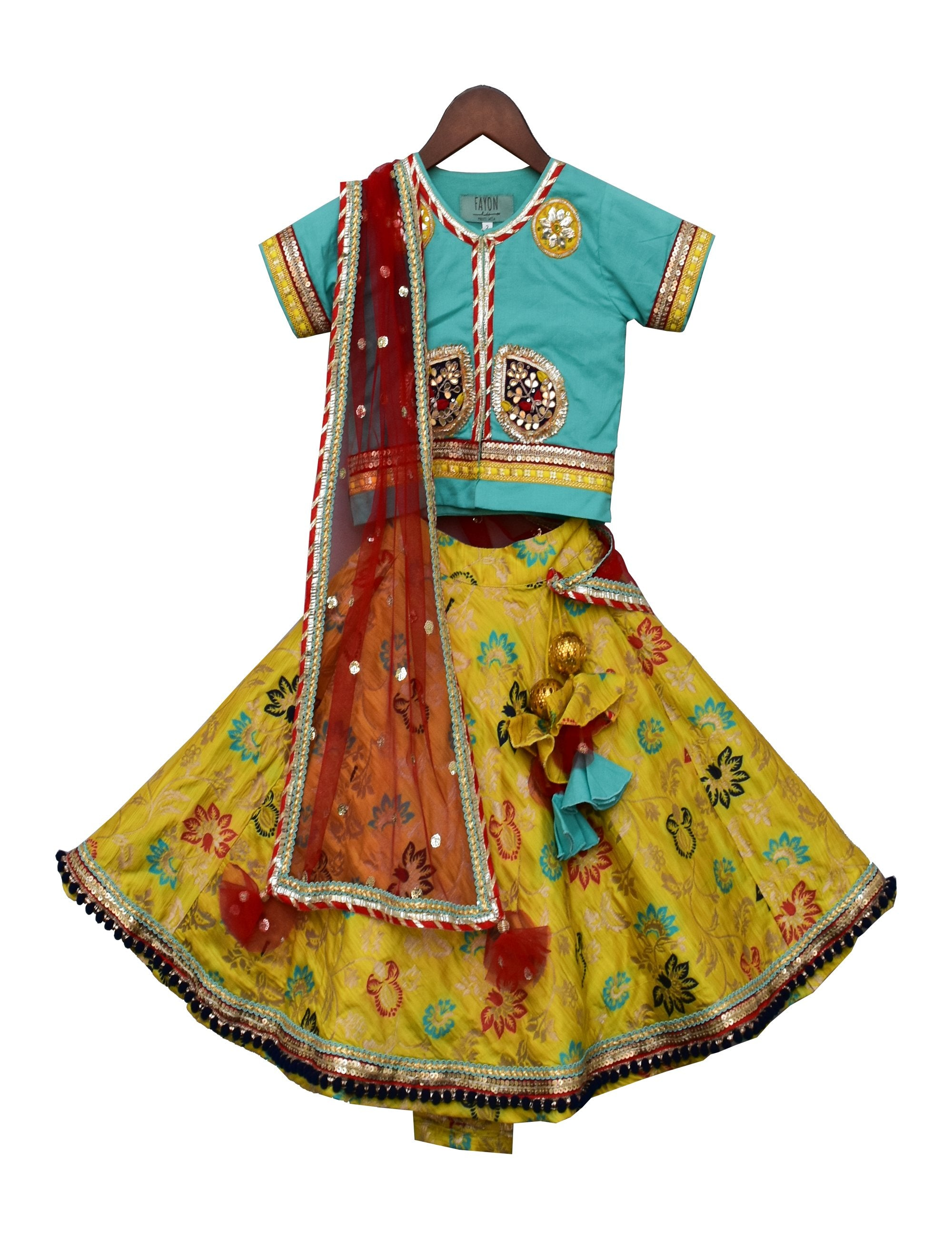 Yellow Brocade Lehenga with Blue Choli.