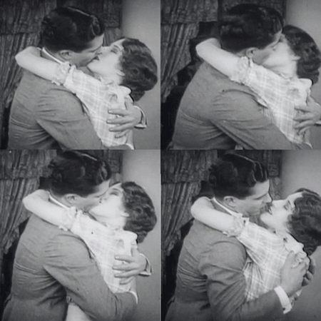classic film couple kissing