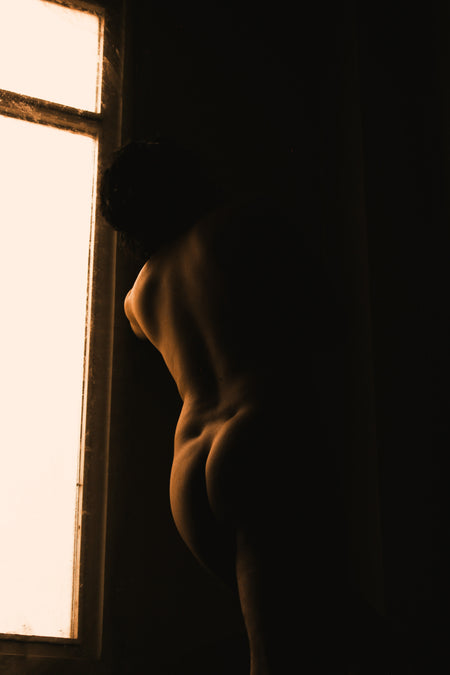 nude woman at a window