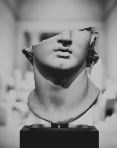 black and white roman statue of mans head