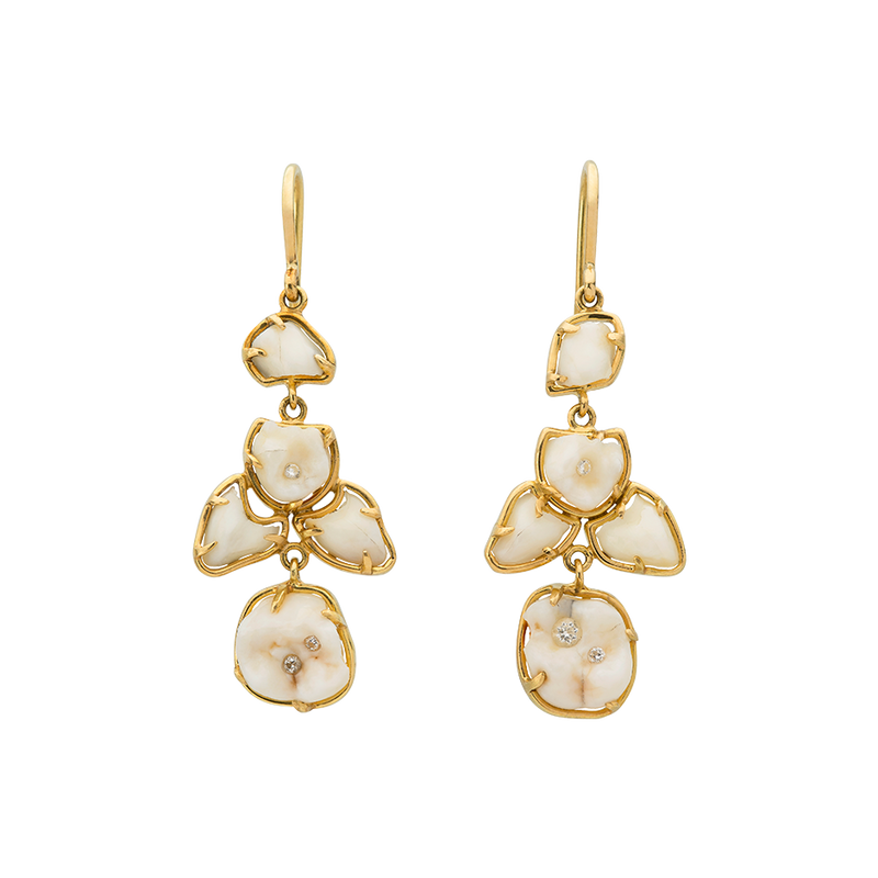 A pair of earrings with milk teeth set in 18 karat yellow gold scattered with diamond fillings by Solange Azagury-Partridge
