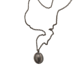 A ball pendant on a chain in blackened 18 karat yellow gold by Solange Azagury-Partridge