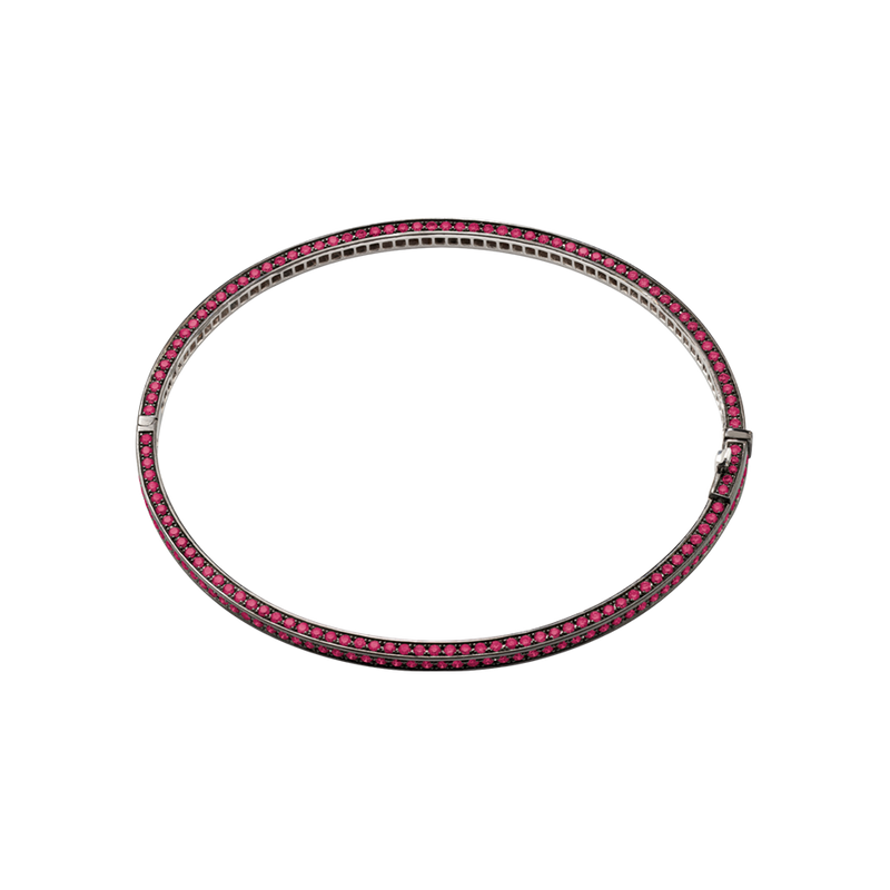 A bangle set on three sides with brilliant cut rubies in blackened 18 karat white gold by Solange Azagury-Partridge