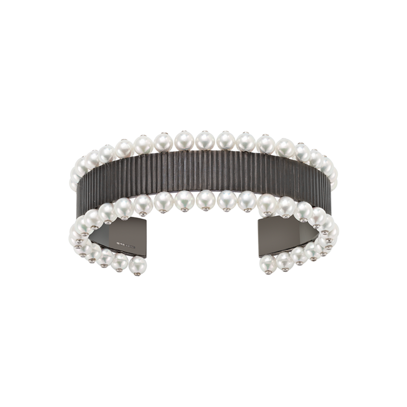 A chromaphobe cuff set with diamond and pearl in blackened 18 karat white gold by Solange Azagury-Partridge