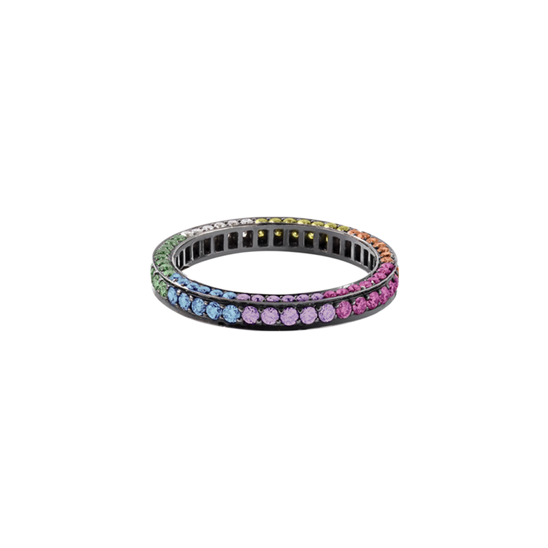 A eternity ring set on three sides with brilliant cut coloured diamonds, sapphires & precious stones in blackened 18 karat white gold by Solange Azagury-Partridge