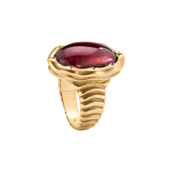 A ring with pink tourmaline with wave engraved surrounded in 18 karat gold by Solange Azagury-Partridge