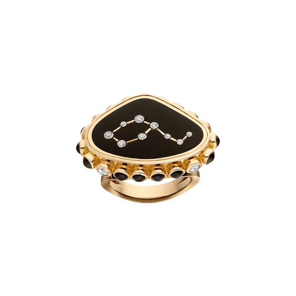 A plaque ring composed of a leo constellation shaped with diamonds set into black onyx with sapphires and diamonds around the edge in 18 karat yellow gold by Solange Azagury-Partridge.