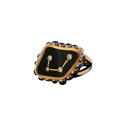 A plaque ring composed of a libra constellation shaped with diamonds set into black onyx with sapphires and diamonds around the edge in 18 karat yellow gold by Solange Azagury-Partridge.