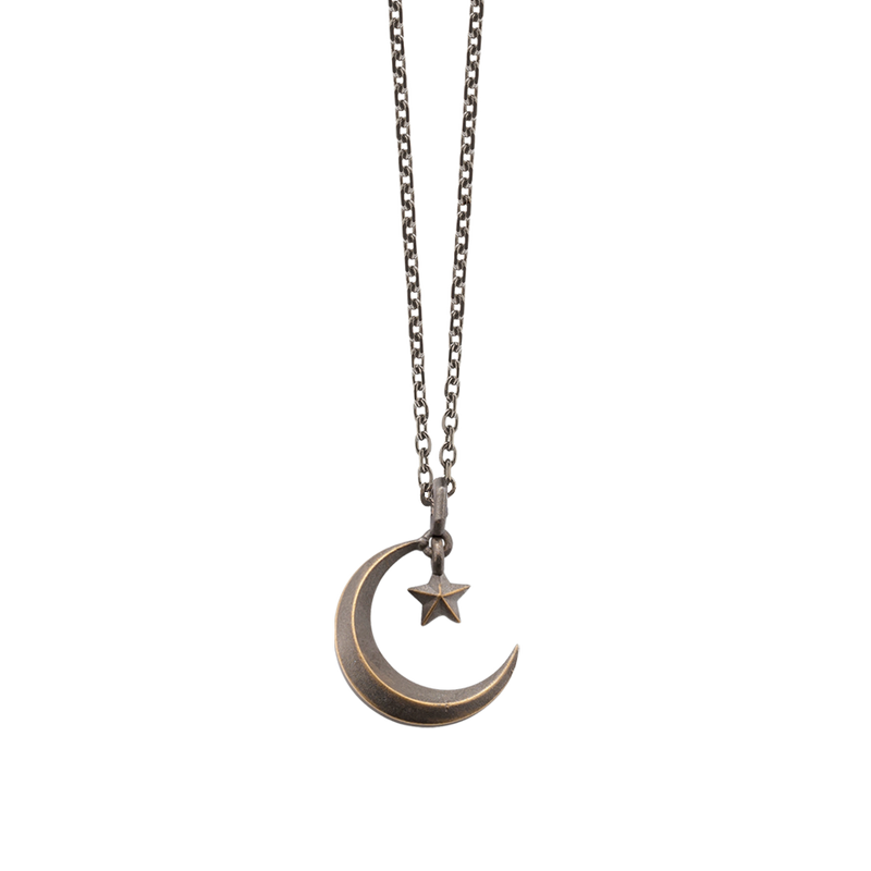 A crescent moon & star pendant in blackened 18 karat yellow gold by Solange Azagury-Partridge
