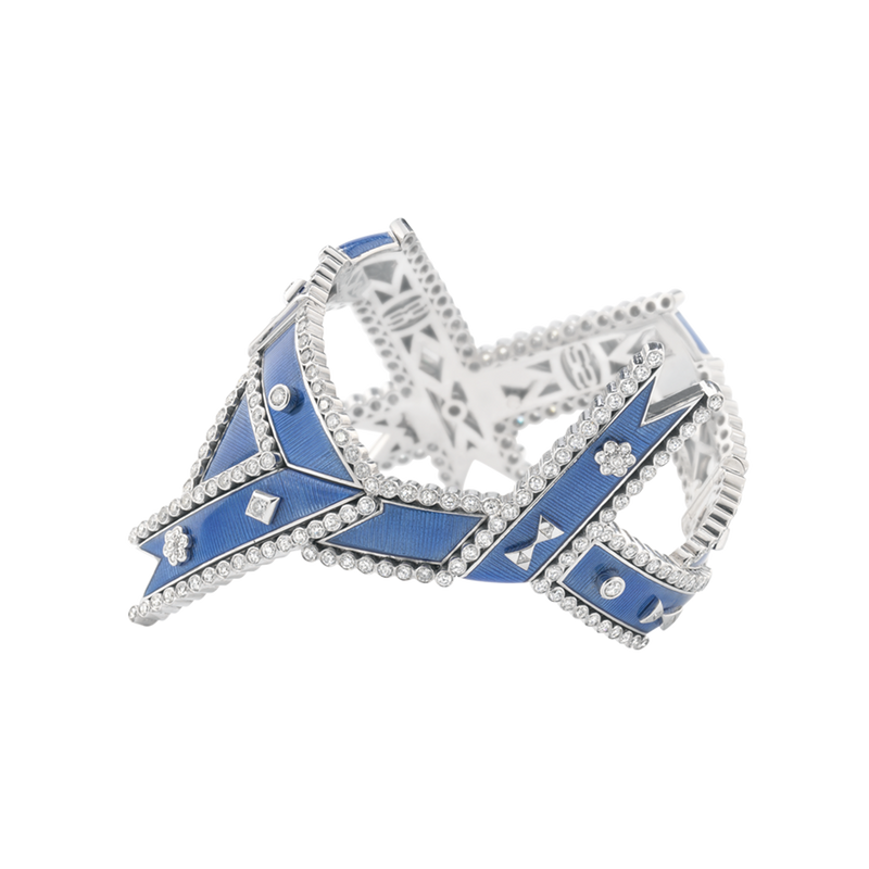 A twisted ribbon motif diamond and blue guilloché enamel regalia cuff in 18 karat white gold by Solange Azagury-Partridge