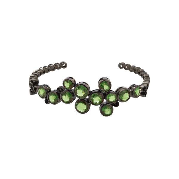 An open green tourmaline and blackened 18 karat white gold bangle by Solange Azagury-Partridge