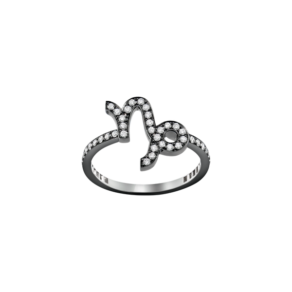A capricorn zodiac sign motif ring set with brilliant cut diamonds in blackened 18 karat white gold by Solange Azagury-Partridge