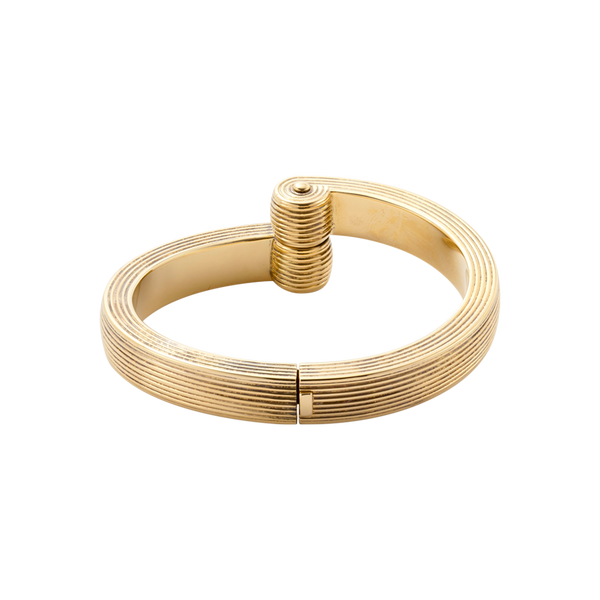 An engraved 18 karat yellow gold  twist bangle by Solange Azagury-Partridge