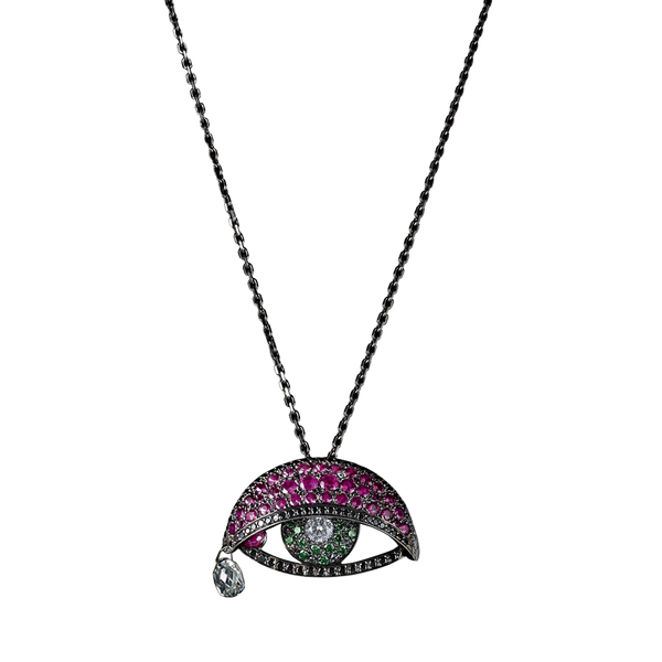 An articulated eye pendant set with white diamonds pupil, emerald iris, black diamonds waterlines, rubies moving lid and tear duct and briolette tear drops in blackened 18 karat white gold by Solange Azagury-Partridge