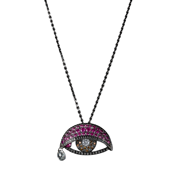 An articulated eye pendant set with white diamonds pupil, citrine iris, black diamonds waterlines, rubies moving lid and tear duct and briolette tear drops in blackened 18 karat white gold by Solange Azagury-Partridge