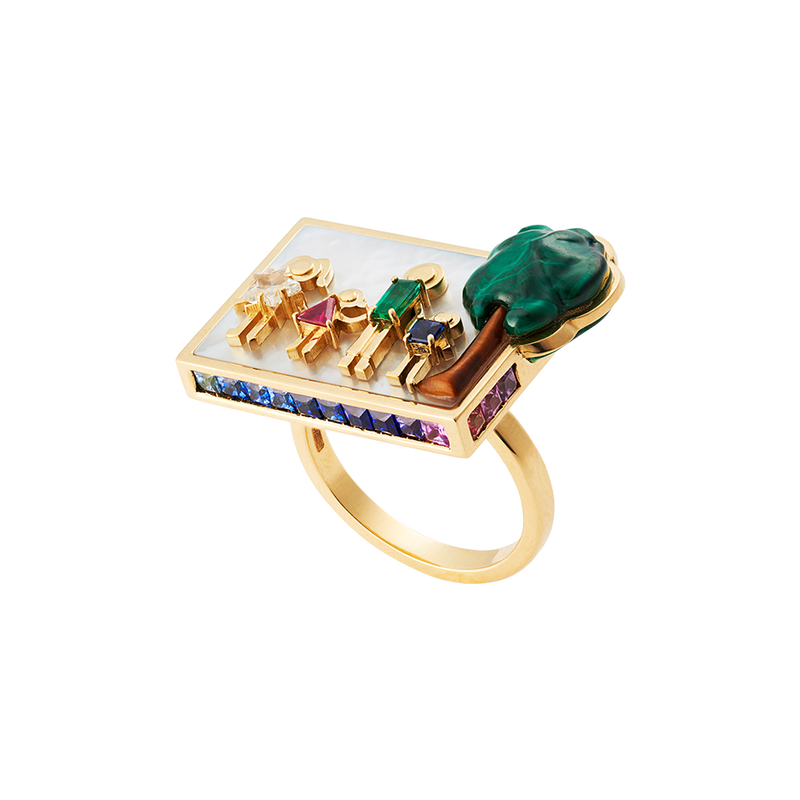 A family plaque ring composed of a family and a tree in diamond, ruby, emerald, sapphire, malachite and tigers eye set on a bed of mother of pearl surrounded by invisibly set sapphires, rubies, and emeralds in 18 karat yellow gold by Solange Azagury-Partridge