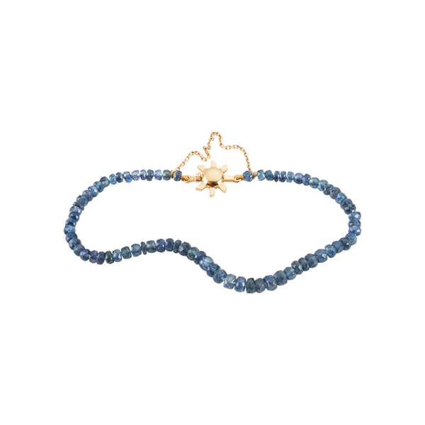A friendship sapphire beaded bracelet with 18 karat yellow gold sun shaped clasp by Solange Azagury-Partridge