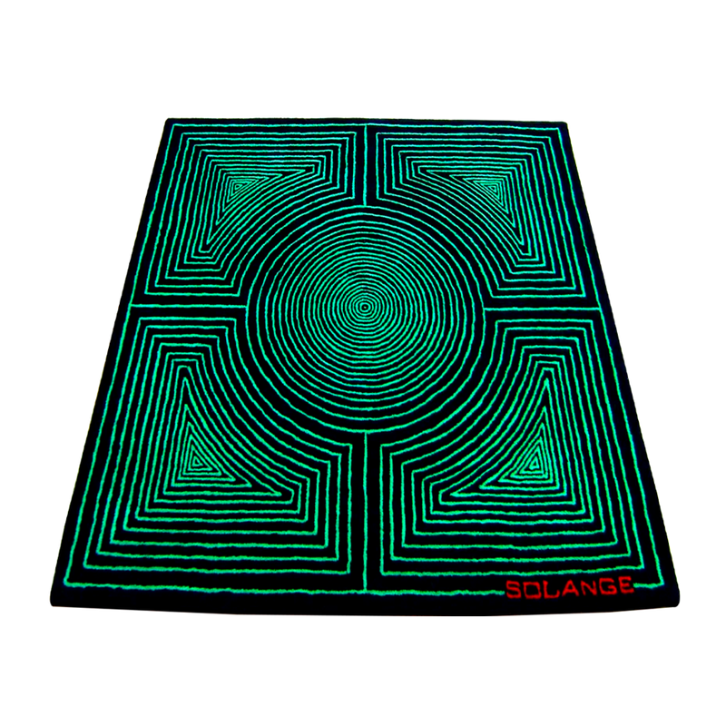 A black and green hypnotic rug in 100% wool by Solange Azagury-Partridge
