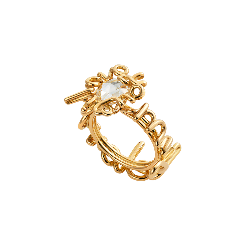 "A written ring with the words ""i love you my beloved"" set with a rose cut diamond in 18 karat yellow gold by Solange Azagury-Partridge"
