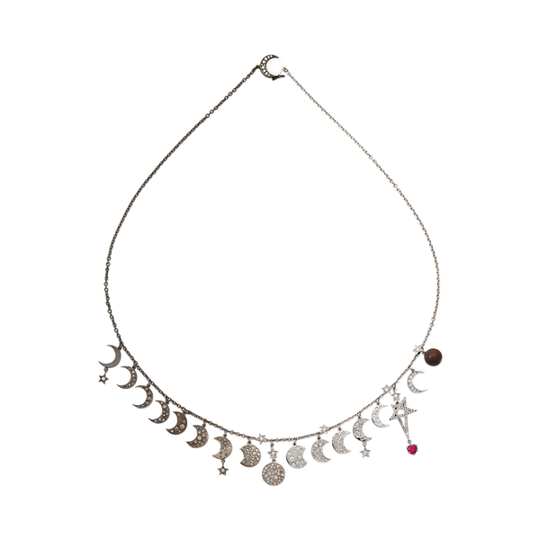 A moon and star motif necklace set with diamonds, a ruby heart and an opal world in blackened 18 karat white gold by Solange Azagury-Partridge