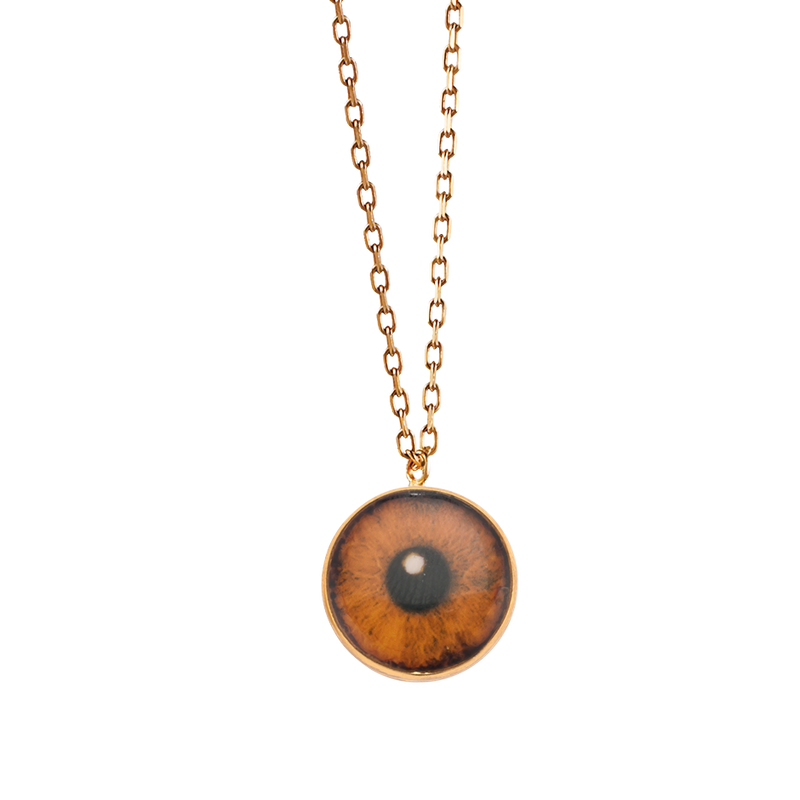 A brown lacquer iris eye necklace in 18 karat yellow gold by Solange Azagury-Partridge