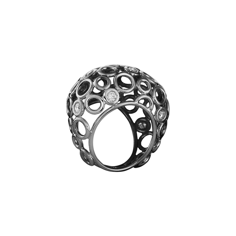 An openwork bombe ring sprinkled with diamonds in blackened 18 karat white gold by Solange Azagury-Partridge